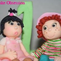 Close Up Of Little Girl And Strawberry Shortcake Topper The mom of the little girl wanted the figurine to have her mouth look as if she was just about to give someone a kiss... that's why...
