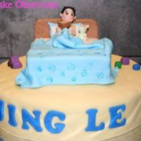 Birthday Cake For A Small Boy Chocolate cake with chocolate buttercream frosting and covered in fondant. The bed was made out of chocolate wafer biscuits and covered in...