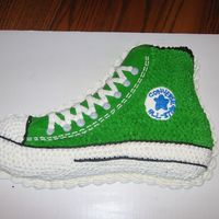 Green Converse This is a green converse shoe that i made for my friends birthday. I carved it to look like a shoe and them the rest is done in buttercreme...