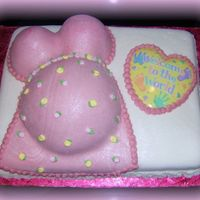 Pregnant Belly Cake  11x15 vanilla sheet cake covered in MMF. 1/2 sports ball and 2 mini wonder molds for the body covered in MMF RI roses and edible sparkle...