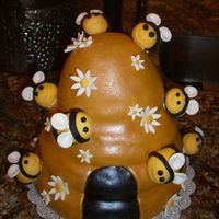 Beehive Cake My second fondant cake all made with MMF and a light dusting of yellow luster dust on hive.