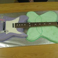 Hannah Montana/tinkerbell Designed by a 6 year old who couldn't decide between a Hannah Montana or Tinkerbell party. Guitar neck graciously donated by a guitar...
