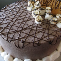 Informal Dinner Party Chocolate graham cake, marshmallow filling, chocolate buttercream. Chocolate drizzle, graham cracker square, toasted mini marshmallows,...