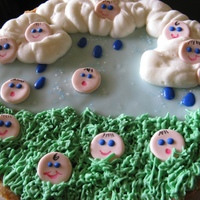 "It's Raining Babies! A baby ""shower"" for a baby shower. HA! Get it?? 9"" orange sugar cookie cake, glace & buttercream with fondant baby heads..."