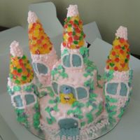 Princess Castle Cake Vanilla cake with strawberry and cream filling. Vanilla buttercream frosting, with fondant and candy accents. The turrets are made from...