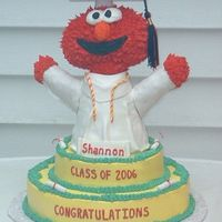 Graduation Elmo Elmo is sculpted from Rice Krispie treats and covered in fondant.