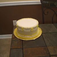 Yellow And White Cake   Cake dummy with yellow and white decorations with buttercream.