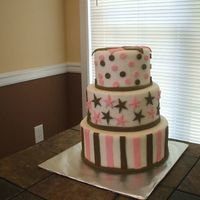 Pink/brown   Cake dummies covered in fondant with fondant decorations