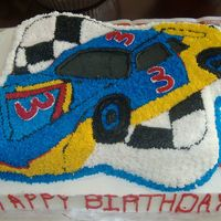 Nascar i made this cake for my son's 3rd birthday. the car cake is white chocolate and the sheet cake is marble chocolate and vanilla.