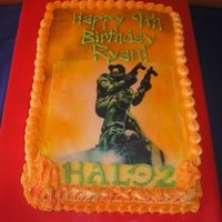 Halo Cake Requested by my 9 year old son! This is a 1/4 sheet cake, 1/2 chocolate, 1/2 vanilla, buttercream icing. Master Chief is an edible image.