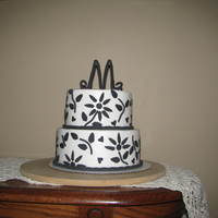 Black And White 2 Tier This is a 8 and 6 inch round chocolate cake with caramel filing and buttercream icing with fondant accents