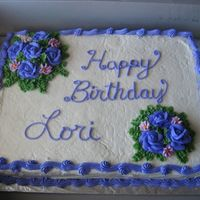 Purple Roses A birthday cake I did for a lady in my office. I got carried away with the leaves, but still learning!