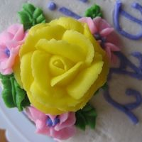 My 1St Rose! This was a cake I did for my mom's birthday. I was taking Course 1 and was only into the class on my 3rd class when I did this).