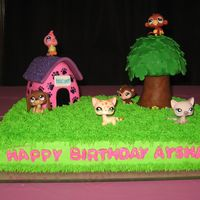 Littlest Pet Shop Birthday Cake This is a cake that I created for my daughters birthday. The tree and dog house are molded from rice crispie treats and then covered and...
