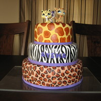 Animal Print Cake THIS IS A CAKE I CREATED FOR MY DAUGHTER'S 10TH B-DAY. IT IS A 3 TIER CAKE. CAKES ARE CHOCOLATE AND VANILLA WITH VANILLA BUTTERCREAM...