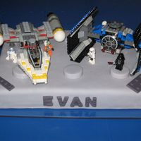 Star Wars Lego Birthday Cake I created this cake for my Lego-maniac son's birthday. It is a bostom cream cake covered with rolled fondant. I rolled fondant thicker...