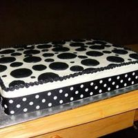 Black And White black and white polka dot cake - all BC with a ribbon around the bottom.