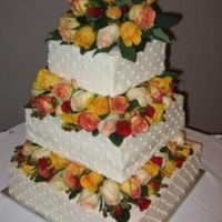 Square Wedding Cake With Real Flowers This was my first wedding cake. I used floral foam between the layers to hold the flowers in place. The rest of the cake was decorated in...