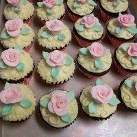 Rose Cupcakes Chocolate Fudge cupcakes with White Chocolate frosting. I made the roses and leaves out of gumpaste.
