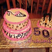 Fabulous 50 Vanilla cake iced in buttercream. Shoe is made of fondat.