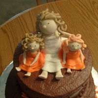 Bride And Flower Girls These figures were made out of gumpaste and put on top of a bridal shower cake. The bride has twin girls, one with red hair and one with...