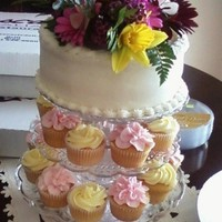 Small Cupcake Stand With A Small Cake On Top   PINK AND YELLOW CUPCAKE AND A WHITE CAKE, WITH FRESH FLOWERS....THANKS FOR LOOKING