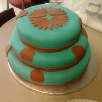 Understated Teal and brown fondant covered cake.