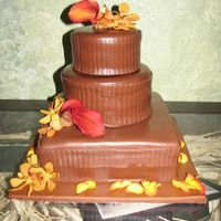 Choco Fondant With Fresh Flower This is my first weeding cake!! 12'' square cake8'' Round Cake6'' Round CakeTheses 3 cakes is all chocolate...