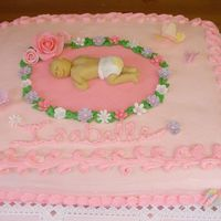 Baby Shower Cake Pink Baby Shower Cake with a fondant baby and butterflies. The left back corner was knocked off at the last minute and I had to repair it....