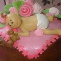 Baby Baby made for baby shower cake. It's my first baby. Teddy Bear is also made with fondant. I loved this one.