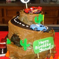 Cars Birthday Cake Cars Birthday Cake for a three year old boy. It's a marble cake with buttercream frosting and fondant accents. The road winds all the...