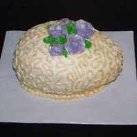 Easter09_024.jpg CSM. Snickerdoodle cake with cinnamon BC. I painted the cornelli lace and the tips of the roses with gold luster dust to give it more of a...