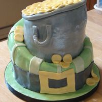 Whimsical St. Paddy's Cake CSM. This was my first whimsical cake. Butter Pecan and Red Velvet. I was VERY happy with how it turned out. Covered in fondant and pearl...