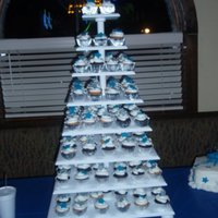 Birthday Cake Tower 160 Cupcakes on Tower with matching silver and blue fondant stars..Matching cake also