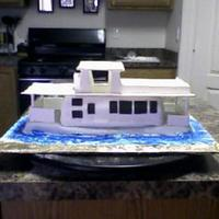 House Boat I made this for my Dad for his birthday. Cake was Spice with apple filling. Covered with fondant.