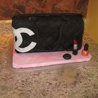 Chanel Purse I did this for my best friends birthday. It was my first sculpted cake,I'm pretty happy with how it turned out. I plan on taking it to...