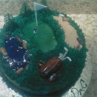 Golf Cake This is a cake I did for an eye doctor's birthday he loved golf so I mad the golf ball and eyeball.