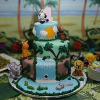 1St Birthday Cake (Jungle Theme)  This is the cake I made for my daughter's 1st birthday. I searched the web and found a bunch of cakes that I borrowed ideas from. Each...