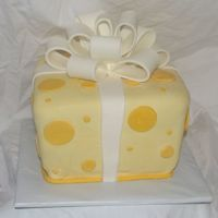 Yellow Whimsy Gift This is an all fondant yellow giftbox I did for our Ethiopia event. I wanted to do one like Duff's which was a tiered version and way...