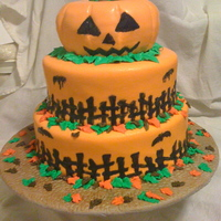 Halloween Cake 3 Tiered fondant covered cake. Bats and fence are royal icing. Unfortunately the RI bled afterwards. :( The leaves are buttercream. Overall...