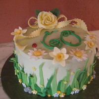 Spring Garden Swiss meringue buttercream with fondant decor around the side and gumpaste on top