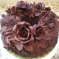 "Chocolate Wreath wreath cake decorated with leaves, roses, acorns, pinecones made with modeling chocolate (chocolate ""clay"")"