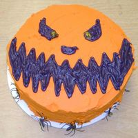 Jack-O-Lantern Face   I made this cake for my 8th Grade ELA class... and they loved it! It is a vanilla cake w/ buttercream frosting.