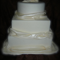 "Simple Yet Elegant Cake dummies covered in fondant with fondant ""fabric"" Fabric was airbrushed with pearl"
