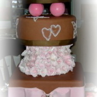 Brown And Pink Wedding Cake For A Live Compitition All cake dummies with chocolate MMF. Flowers are gumpaste. globes are Styrofoam covered with balloons. Of course this is the touched up...
