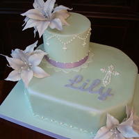 First Holy Communion Lily's cake with purple fantasy gumpaste lilies.