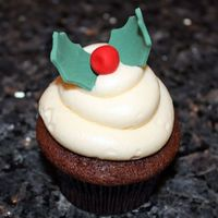 Holly Cupcakes Gingerbread cupcakes topped with eggnog flavored buttercream and fondant holly leaves and berries. Made for a Christmas party - and didn&#...