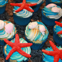 By The Sea Cupcakes! I made the shells and starfish using fondant molds. The cupcakes are chocolate with vanilla buttercream. They were made for my graduating...