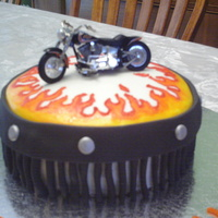 Harley Cake Painted on flames with food coloring, used fondant for details. Bike is a toy. Harley symbol done with royal icing and color flow. Got this...