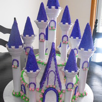 Castle Cake For a 3 yr old, Wilton Castle assessories. Top teir, strawberry/vanilla cake with strawberry filling; bottom teir chocolate with chocolate...
